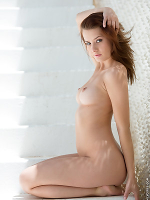Redhead babe Anna Tatu strips off her clothes revealing her puffy hairy pussy - image 16