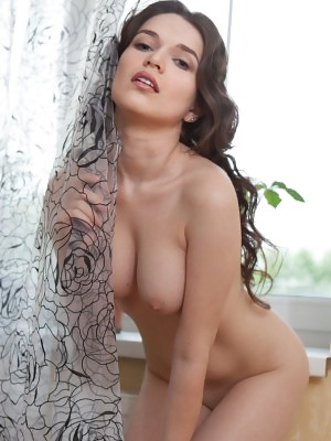 Serena Wood displays her gorgeous body and sweet pussy by the window