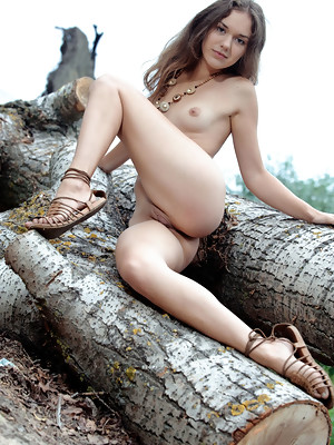 Jenya A spreads her legs wide open baring her sweet pussy outdoors - image 11