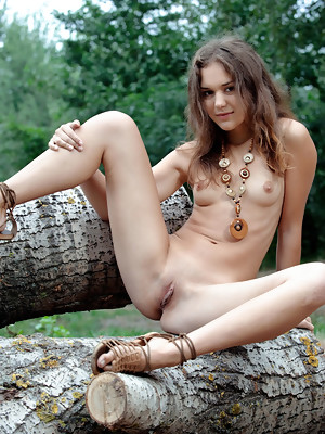 Jenya A spreads her legs wide open baring her sweet pussy outdoors - image 16