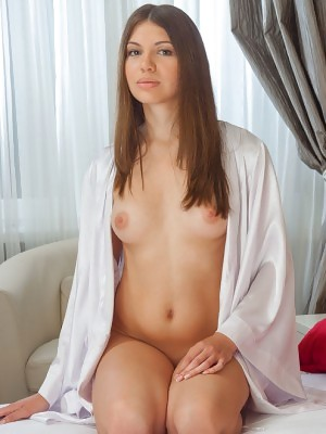 Satila sensually poses on the bed baring her luscious body with pink nipples and pink pussy