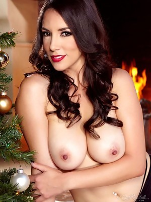 Jelena Jensen pops out big boobs and hairy snatch in Christmas Present at Holly Randall