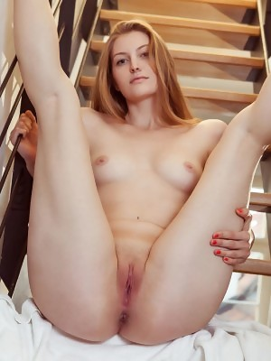 Bretona bares her slender body with pink nipples and amazing butt on the stairs