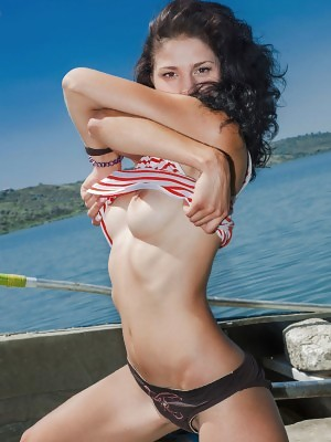 Callista B shows off her smoking hot body as she poses by the beach