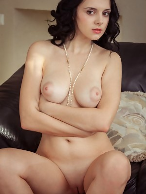 Beautiful Anatali flaunts her beautiful breasts and pink pussy on the sofa