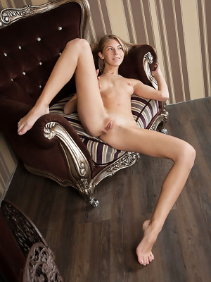 Anjelica bares her petite body and delectable pussy on the couch - image 18