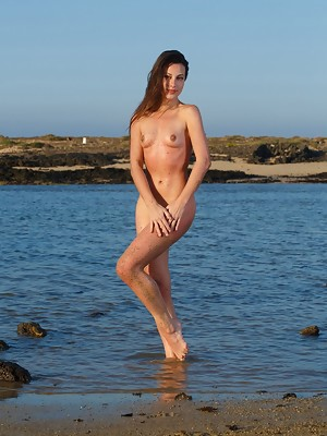 Vibrant and playful Lorena B in a bright smile as she basks naked in the morning sun - image 5