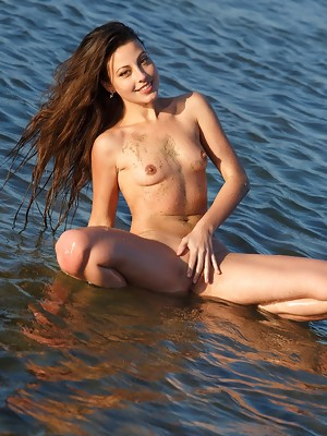 Vibrant and playful Lorena B in a bright smile as she basks naked in the morning sun - image 9
