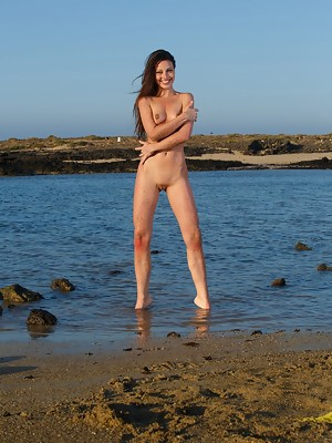 Vibrant and playful Lorena B in a bright smile as she basks naked in the morning sun - image 14