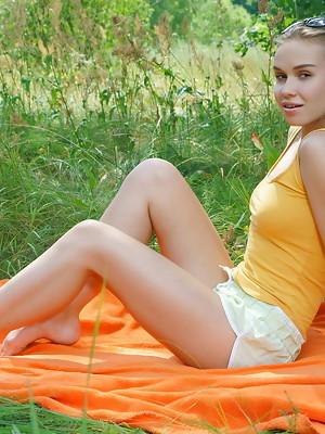 Lucretia enjoys an uninhibited outdoor masturbation - image 1