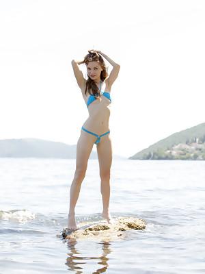 Sofi Shane showcasing her petite body by the beach - image 1