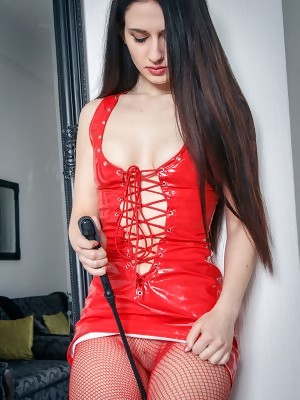 Eva Kahil strips her red latex dress with matching fishnet stockings as she bares her delectable pussy