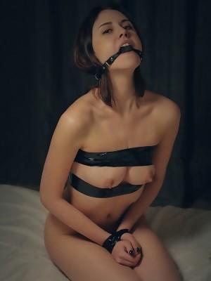 Kinky Sade Mare poses seductively to entice bondage play