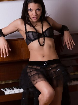 Isha erotically poses on the piano baring her lusty body