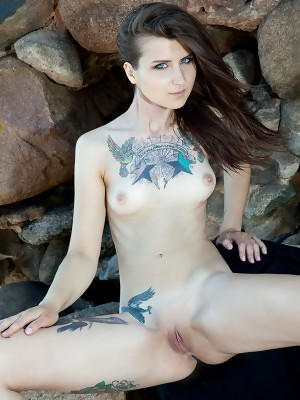 Ida shows off her gorgeous tattooed baody and sweet pussy outdoors
