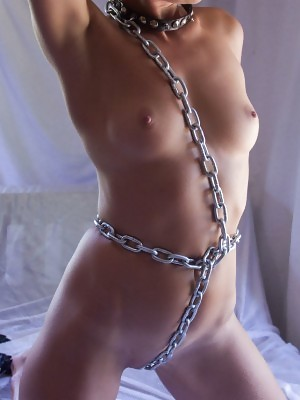 Lindra shows off her sexy chained body and delectable pussy