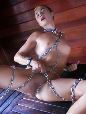 Lindra bares her lusty chained body in front of the camera