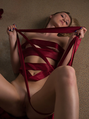 Diana B bares her slender body as she sensually poses on the floor - image 16