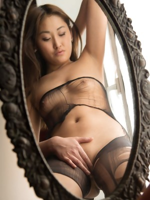 New model Olga bares her lusty body and trimmed pussy by the window