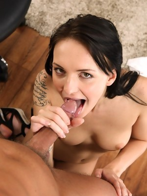 Gorgeous secretary Belle Claire performs a blowjob