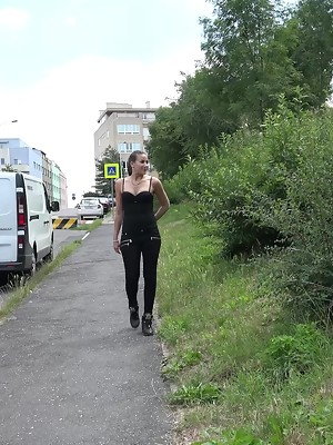 Hot teen in black denims Yenna is pissing outdoors - image 1