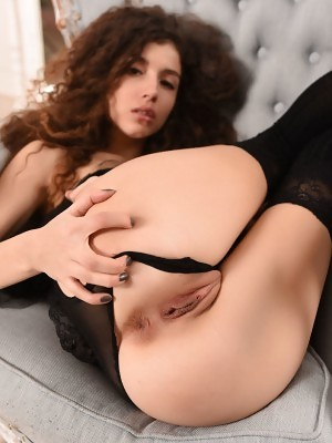 Incredible hottie Curly shows off her tiny boobs and shaved pussy