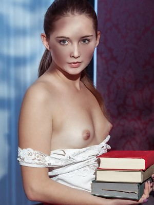 Passionate bookworm Kristy exposes her naughty side and yummy nipples