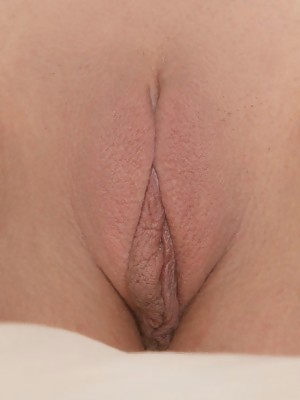 Lovely Suzy is showing her pink pussy by taking a few shots up close and personal