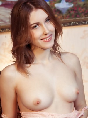 Sexy cutie Odette is undressing and exposing her incredibly shaped body