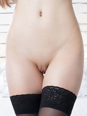 Horny beauty in stockings Missy shows her fine pussy before the camera
