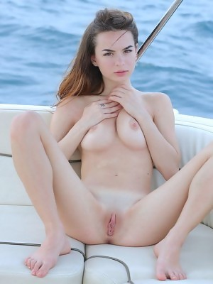 Kelly strips naked on the yacht and reveals her wonderful pussy