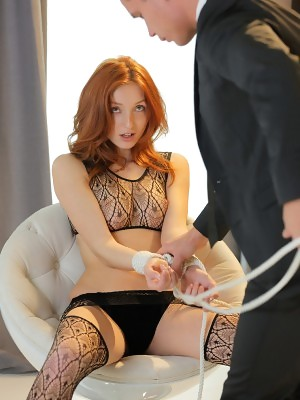 Tied up redhead nymph in alluring black lingerie The Red Fox makes playful and passionate love with couple of real orgasms