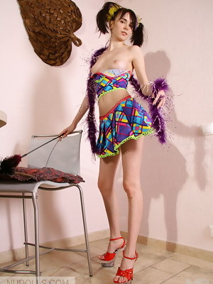 Young brunette schoolgirl with pigtails poses in mini skirt and masturbates - image 3