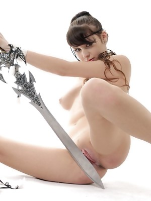Curly haired stunning goddess Tory is posing with sword