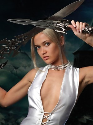 Stunning Amazon babe Nelly stands with swords but without panties