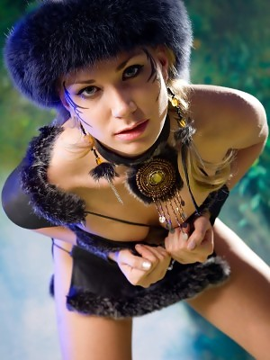 Brunette Alice is posing in viking costume and shows wet pussy