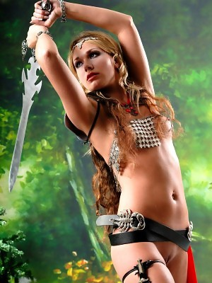 Sexy topless Amazon blonde Alice is posing with two swords and masturbates