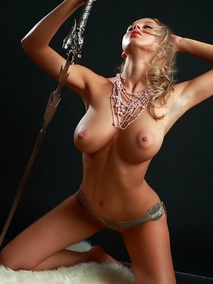 Sexy busty blonde Aelita is posing with real sword