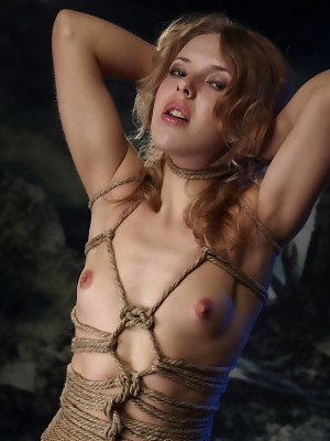 Curly small titted babe Agneta gets tied tight with ropes