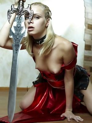 Small breasted Amazon blonde girl Dani has one huge sword