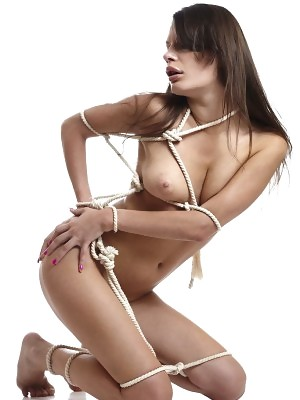 Tall brunette babe Salma poses tied up in ropes