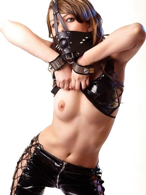 Horny babe Fiona poses gagged in latex and handcuffs