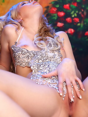 Sexy curly blonde goddess Dani poses in silver dress without panties - image 18