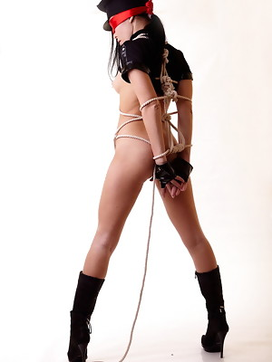Black hair police girl Polly is getting tied up and naked - image 17