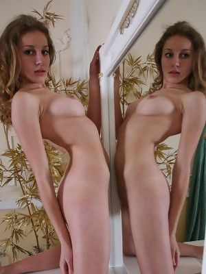 Curly blonde with big firm tits Janetta is getting naked and spreading legs