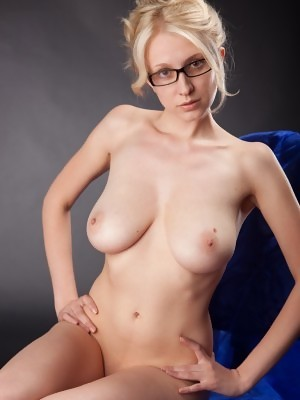 Busty blonde teacher Katy is posing naked wearing just her glasses
