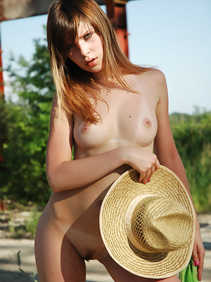 Naughty girl Rimma gets out of her clothes near a construction site - image 18