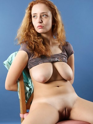 Nice young Penny shows off her steaming curves and amazing big tits